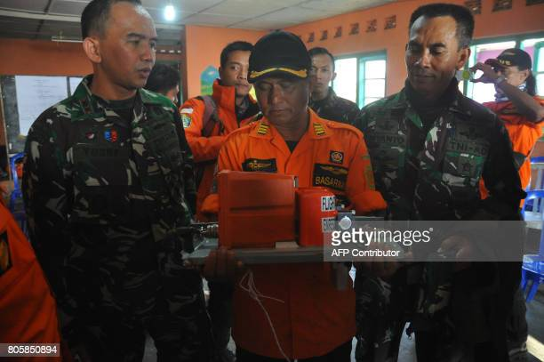 Indonesian officials hold a black box from a helicopter that crashed in Temanggung on July 3 2017 Eight rescuers were killed on July 2 after an...
