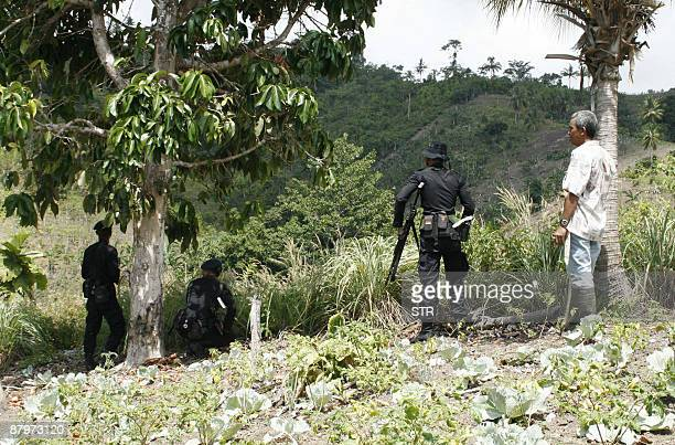 Indonesian paramilitary police get ready to retake a remote jungle airstrip seized by armed separatists in Tanah Hitam village near Papua province...