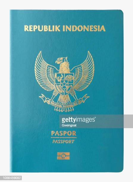 indonesian passport isolated on a white background - gwengoat stock pictures, royalty-free photos & images