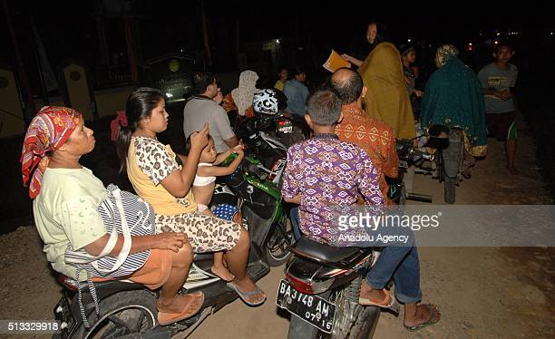 Indonesian people are seen on highway as they go to higher grounds in Padang West Sumatra Indonesia on March 2 2016 after a powerful earthquake...