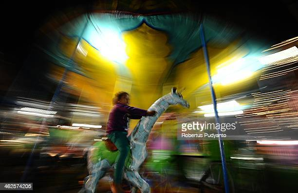 Indonesian people attend to night market during Sekaten festival on January 14 2014 in Solo City Indonesia Indonesia celebrates the birth of Prophet...