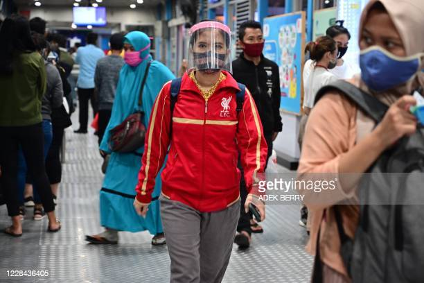 Indonesian people commute in Jakarta on September 10, 2020. - Indonesias capital Jakarta plans to re-impose a partial lockdown as early as September...