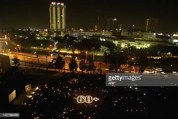 Indonesian people light candles during the Earth Hour in Surabaya on March 31, 2012. From Sydney's sparkling harbour to Egypt's Tahrir Square and New...
