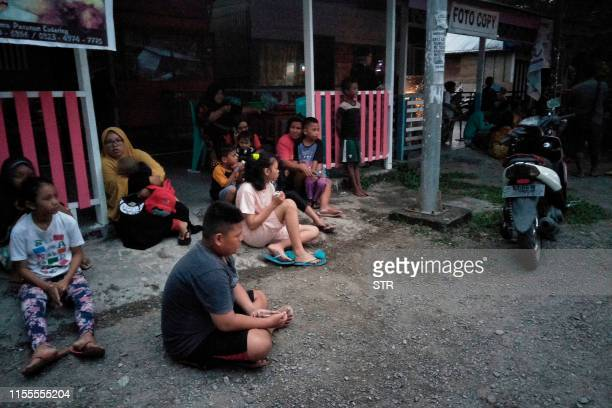TOPSHOT Indonesian people stay out of their homes following 73 magnitude earthquake in Labuha North Maluku on July 14 2019 A major 73magnitude...