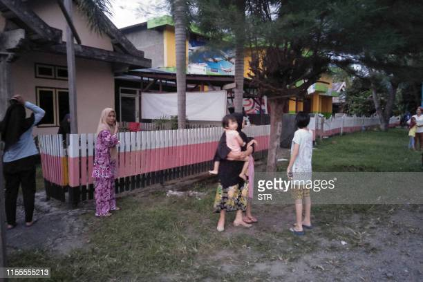 Indonesian people stay out of their homes following 73 magnitude earthquake in Labuha North Maluku on July 14 2019 A major 73magnitude earthquake hit...