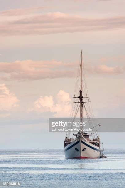 indonesian phinisi schooner at sunset - 帆船 ストックフォトと画像