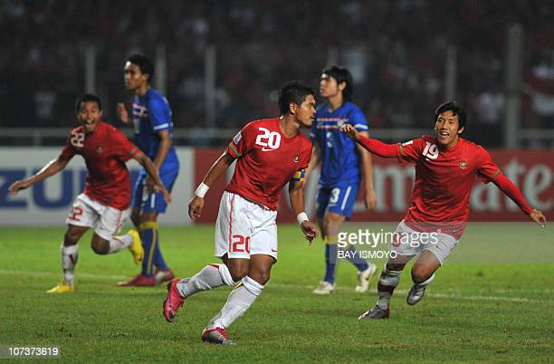 Indonesian players celebrate their second goal by Bambang Pamungkas during their AFF Suzuki Cup 2010 group A football match in Jakarta on December 7...