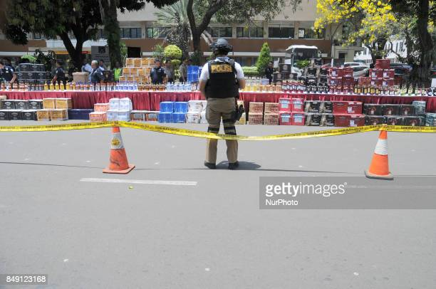 Indonesian police and customs officers examined the evidence of alcohol smuggling cases at regional police headquarters Jakarta Indonesia on...