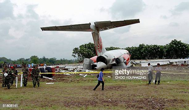 Indonesian police and soldiers stand guard next to the wreckage of Lion Air plane at the accident site near Solo international airport Central Java...