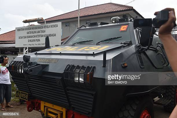 Indonesian police armored vehicles carrying Australians on death row Andrew Chan and Myuran Sukumaran leave the maximum security prison in Nusa...