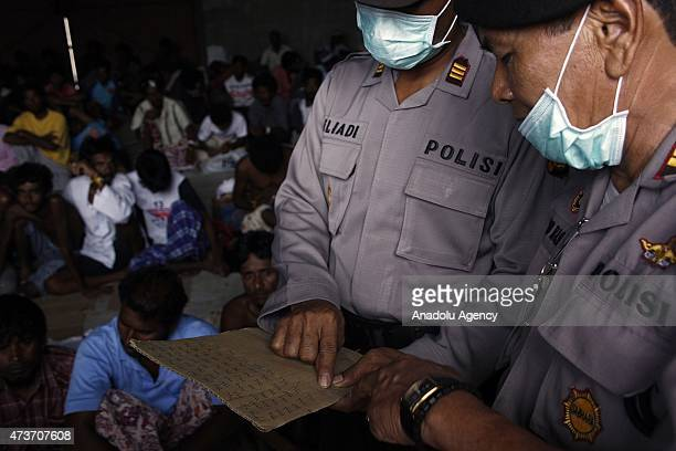 Indonesian police check name of Rohingya people at temporary shelter on May 17 2015 in Langsa Aceh Indonesia Indonesia is reported to be sheltering...