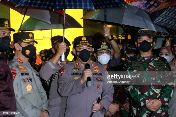 Indonesian Police Chief, General Listyo Sigit Prabowo accompanied by TNI Commander, Marshal Hadi Tjahjanto speaks to media after visiting the site of...