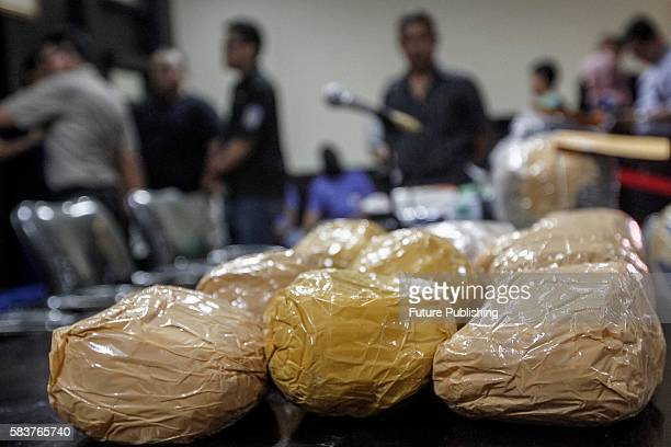 Indonesian police display 60 kilograms of methamphetamine smuggled from Cameroon and Malaysia during a press conference on July 27 2016 in Jakarta...