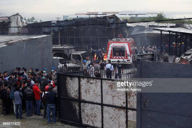 Indonesian police officer evacuated a body bag containing the bodies of fire victims at a fireworks factory in Tangerang Indonesia on October 26 2017...