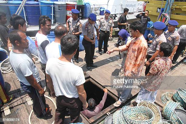 Indonesian Police officers catch illegal Malaysian fishing boats and 11 crews from Thailand 3 from Myanmar on March 16 2016 in Indonesian sea Langsa...