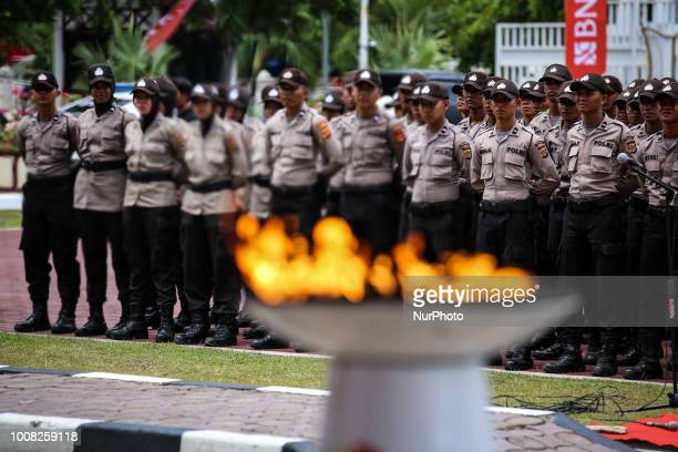 Indonesian police officers during Asian Games torch at the beginning of Asian Games 2018 torch relay ahead of the August 18 September 2 games held at...