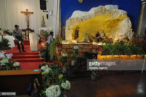 Indonesian Police officers take security measures ahead of Christmas in St Antonius church in Jakarta Indonesia on December 24 2015 Indonesian...