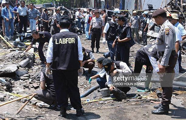 Indonesian police search for evidence at the site of a bomb blast that hit the tourist area of Kuta in Denpasar on the Indonesian resort island of...