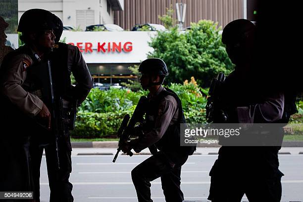 Indonesian police search for suspects after a series blasts hit the Indonesian capital on January 14 2016 in Jakarta Indonesia Reports of explosions...