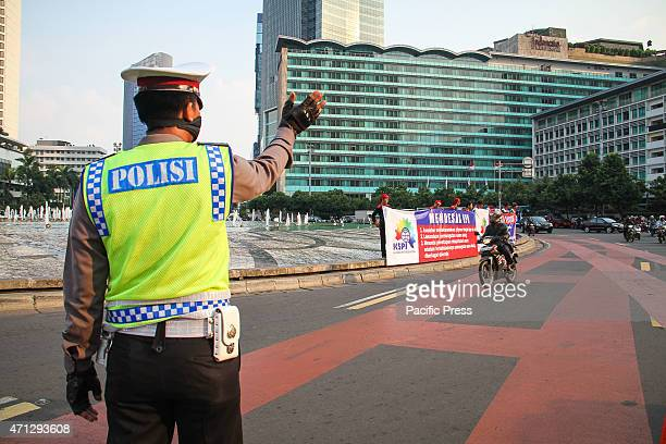 Indonesian police stand guard around the Indonesia general election commission building as Indonesia awaits results of presidential election on July...