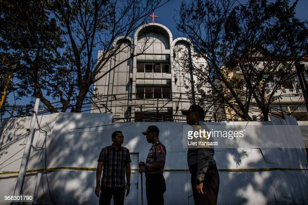 Indonesian police stand guard infront of Surabaya Centre Pentecostal Church, following a blast at the church a day earlier on May 14, 2018 in...