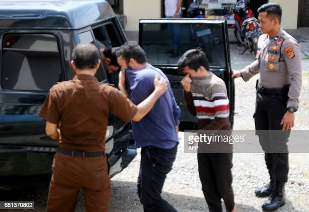 Indonesian police take away two men accused of having sex in contravention of sharia law in Banda Aceh on May 10 2017 Prosecutors in Indonesia's Aceh...