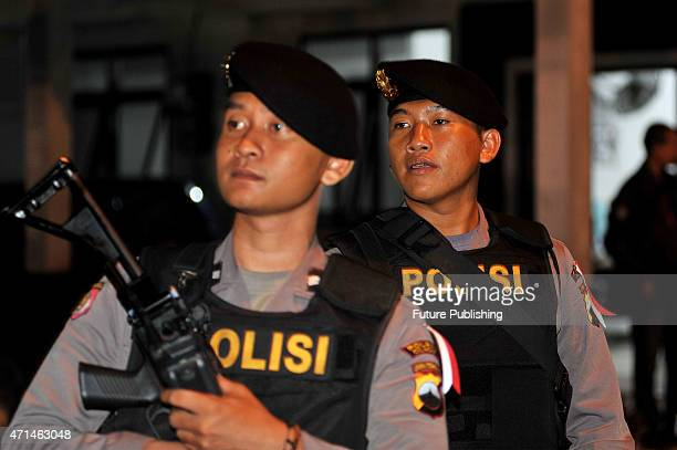 Indonesian police tightens security measures at a port where ferries cross to Nusakambangan prison island ahead of scheduled executions of drug...