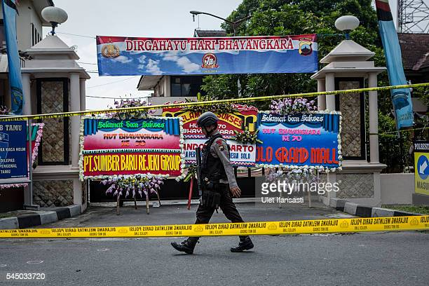 Indonesian police walks as guard after a suicide bomb attack at the Police station on July 5 2016 in Solo City Central Java Indonesia A suicide...