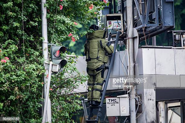 Indonesian policemen investigate the blast site after a series of explosions hit the Indonesia capital on January 14 2016 in Jakarta Indonesia...