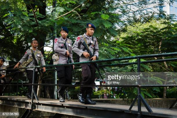Indonesian Policemen patrol a bridge over a canal in central Jakarta on April 19 2017 in Jakarta Indonesia Police at Indonesia's capital have said...