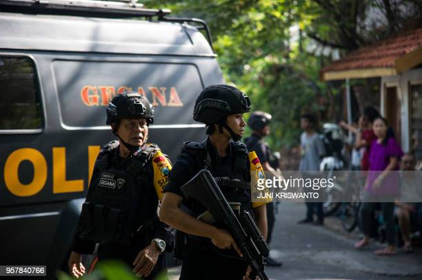 Indonesian policemen patrol outside a church following a suicide bomb in Surabaya on May 13 2018 At least two people were killed and 13 others...