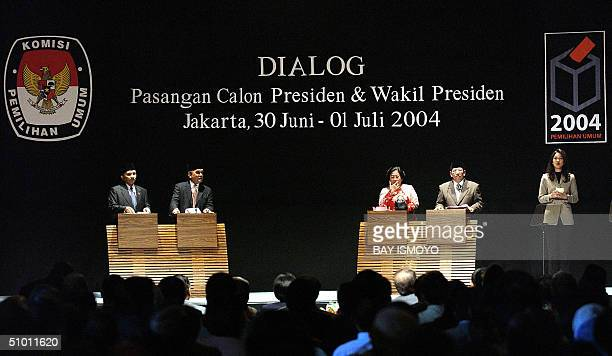 Indonesian presenter Ira Koesno hosts a televised debate between presidential candidate Amien Rais and his runningmate Siswono Yudo Husodo and...