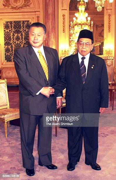 Indonesian President Abdurrahman Wahid and Japanese Prime Minister Yoshiro Mori shake hands prior to their meeting ahead of the funeral of late...