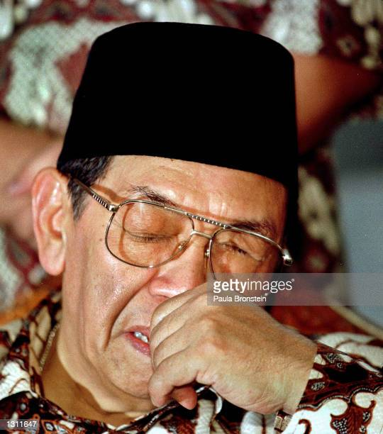 Indonesian President Abdurrahman Wahid Gus Dur pauses while speaking to the press and members of his mosque after participating in Friday noon Muslim...