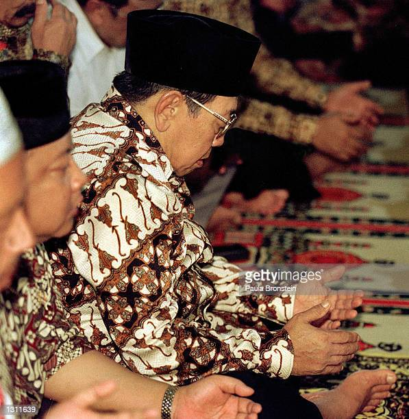 Indonesian President Abdurrahman Wahid Gus Dur prays with members of his mosque June 1 2001 after participating in Friday noon muslim prayers in...