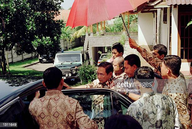 Indonesian President Abdurrahman Wahid Gus Dur walks from his residence to a vehicle June 1 2001 in Ciganjur South Jakarta Wahid terminated key...