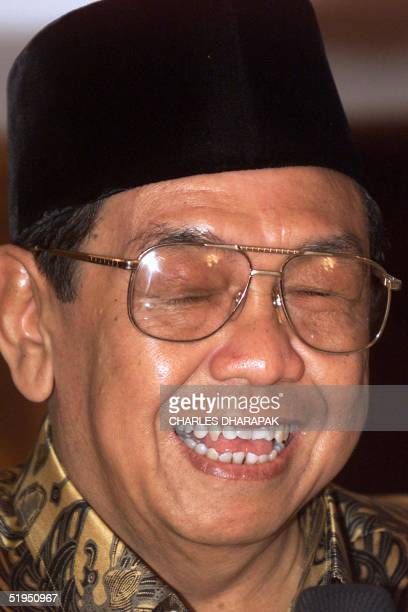 Indonesian President Abdurrahman Wahid laughs during a lunch with local and foreign journalists at the president's summer palace in Bogor West Java...
