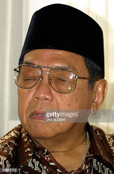 Indonesian President Abdurrahman Wahid listens during a meeting with the Head of Algeria's Parliament Abdelkader Bensalah at Lagoon Tower Hilton...