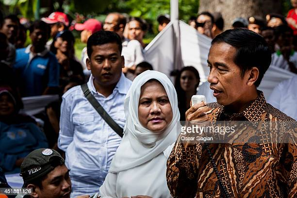 Indonesian president candidate Joko Widodo speaks after casting his ballot on July 9 2014 in Jakarta Indonesia Election day in Indonesia sees locals...