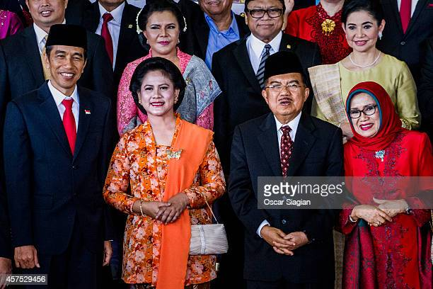 Indonesian President Joko Widodo and First Lady Iriana and Vice President Jusuf Kalla and wife pose for photo after the inauguration ceremony for...