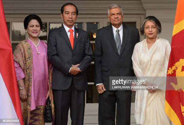 Indonesian President Joko Widodo and his wife Iriana pose with Sri Lankan Prime Minister Ranil Wickremesinghe and his wife Maitree Wickremesinghe...