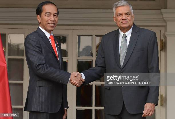 Indonesian President Joko Widodo and Sri Lankan Prime Minister Ranil Wickremesinghe shake hands during a meeting in Colombo on January 25 2018 Widodo...