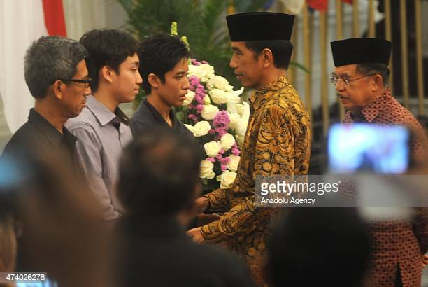Indonesian President Joko Widodo and Vice President Jusuf Kalla chats to Indonesian Ambassador Burhan Muhammad's families during a funeral ceremony...