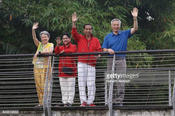 Indonesian President Joko Widodo and wife, Iriana and Singapore Prime Minister, Lee Hsien Loong and wife, Ho Ching pose for a photo at The Learning...