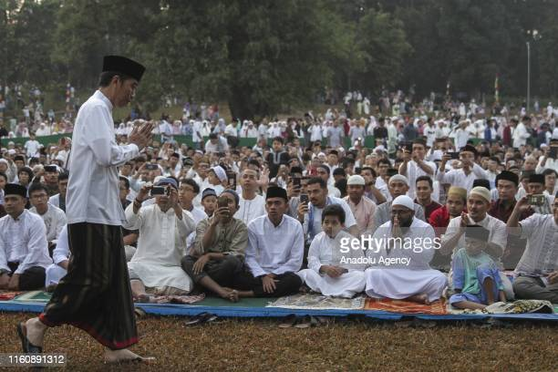Indonesian President Joko Widodo arrives at Astrid Park of Bogor Botanical Gardens to perform Eid alAdha prayer in Bogor Indonesia on August 11 2019...