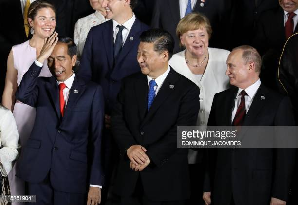 Indonesian President Joko Widodo, Chinese President Xi Jinping, German Chancellor Angela Merkel and Russian President Vladimir Putin are pictured as...