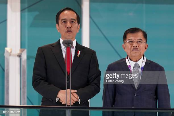 Indonesian President Joko Widodo delivers a speech next to Indonesia's Vice President Jusuf Kalla during the opening ceremony of the Asian Games on...