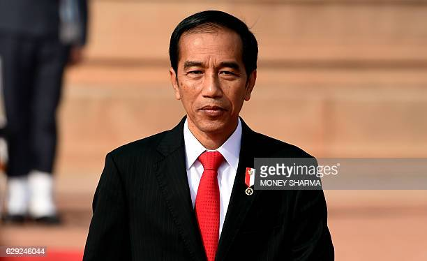 Indonesian President Joko Widodo inspects a guard of honour during a ceremonial reception at the Presidential Palace in New Delhi on December 12 2016...