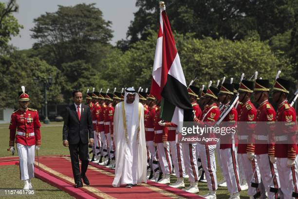 Indonesian President Joko Widodo inspects honor guards with Crown Prince of Abu Dhabi and Deputy Supreme Commander of the United Arab Emirates Armed...