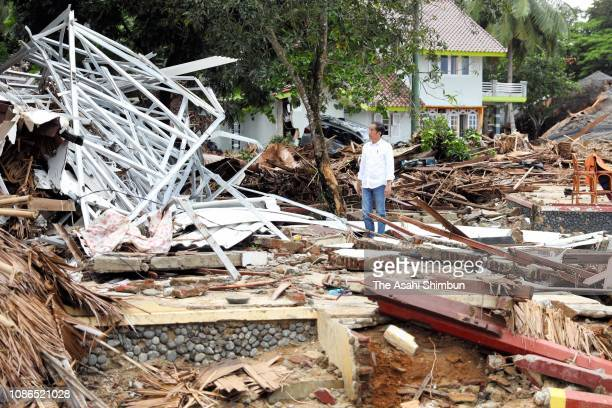 Indonesian President Joko Widodo inspects the damage after hit by tsunami on December 24 2018 in Carita Banten province Indonesia Over 280 people...